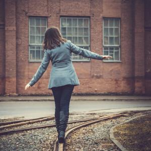 girl walking on the railway